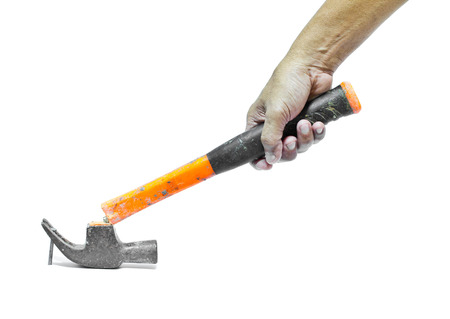 Broken hammer in hand on a white background  Imagens