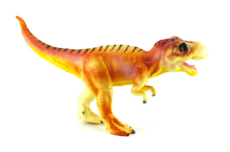 Tyrannosaurus dinosaur toy isolated on white photo