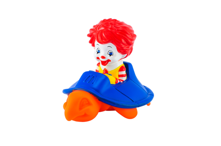 Babie: Bangkok,Thailand - April 03, 2014: Toddler ronalds riding an orange turtle.This toy sold for under 3 year form McDonalds Happy Meal Toys.