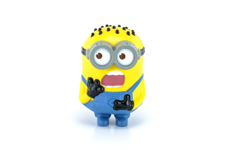 Bangkok,Thailand - April 30, 2014: Minion  Tom Babbler figure Toy. There are plastic toy sold as part of the McDonalds Happy meals.