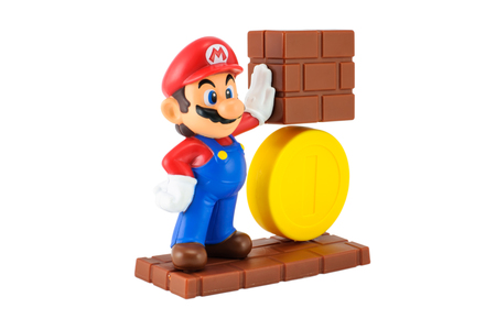 nintendo: Bangkok,Thailand - May 13 2014: Super Mario with gold coin. There are plastic toy sold as part of the McDonalds Happy meals. Editorial