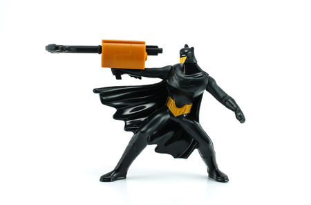 mcdonald: Bangkok,Thailand - April 29, 2014  Batman hold a gun figure Toy  There are plastic toy sold as part of the McDonald Editorial