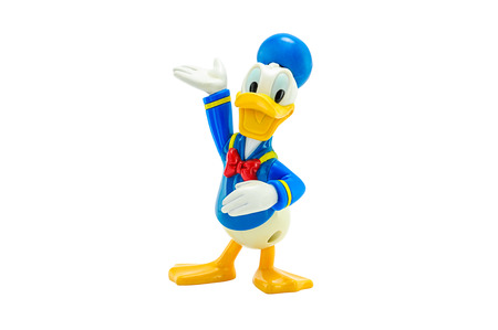 BANGKOK, THAILAND - June 2, 2014 : Donald Duck wears a sailor suit with a cap and a black or red bow tie toy figure. There are toy sold as part of McDonald HappyMeal toy.