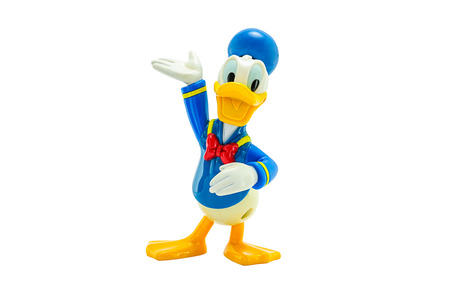donald: BANGKOK, THAILAND - June 2, 2014 : Donald Duck wears a sailor suit with a cap and a black or red bow tie toy figure. There are toy sold as part of McDonald HappyMeal toy.