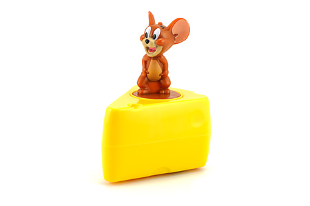 Bangkok, Thailand - July 31, 2014 : Jerry on a pice of cheese  toy character American animated series. There are toy sold as part of McDonald Happy Meal toy.