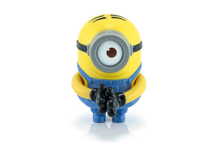 grabber: Bangkok,Thailand - August 31, 2014: Minion Stuart babbler grabber toy character from Despicable Me 2 movie. There are plastic toy sold as part of the McDonald Editorial