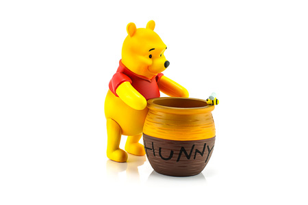 Bangkok, Thailand - July 28, 2014 : Figure of Winnie the Pooh and hunny pot. Winine the Pooh is animation from Disney. Editorial