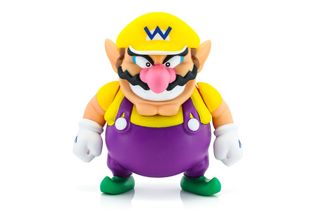 ead: Bangkok, Thailand - August 31, 2014 : Wario Man figure character from Super Mario video game console developed by Nintendo EAD.