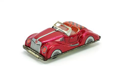 carritos de juguete: Juguete de hojalata coche aislado en el fondo blanco. Editorial