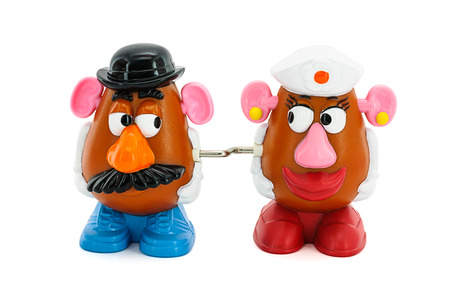 toy story: BANGKOK, THAILAND - June 28, 2014 : Mr. and Mrs. Potato Head toy character from Toy Story movie. There are toy sold as part of McDonald HappyMeal toy.