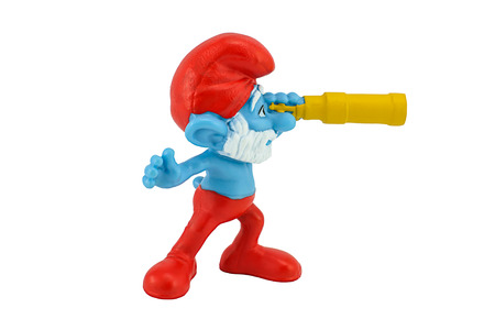 BANGKOK, THAILAND - July 20, 2014 : PAPA Smurfs hold a monocular  toy character from smurfs movie. There are toy sold as part of McDonald Happy Meal. Redactioneel