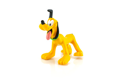 Bangkok,Thailand - October 11, 2014: Pluto dog figure toy model character from Disney  Mickey mouse and friend.