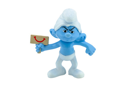 grouchy: Bangkok,Thailand - October 2, 2014: Grouchy Smurf hold a happy sign toy figure model character from The Smurf movie.  There are plastic toy sold as part of the McDonalds Happy meals. Editorial