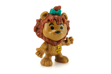oz: Bangkok, Thailand - December 12, 2014: Cowardly lion ction figure from Wizard Of Oz movie. There are plastic toy sold as part of the McDonalds Happy Meal toys. Editorial