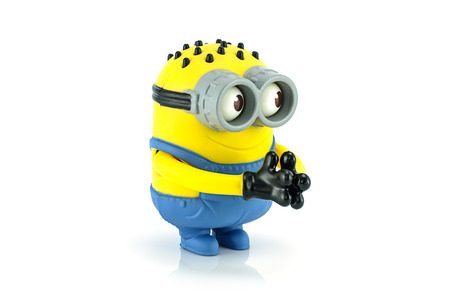 grabber: Bangkok,Thailand - October 11, 2014: Minion Tom Googly Eyes Grabber toy character from Despicable Me animation movie. There are plastic toy sold as part of the McDonalds Happy meals. Editorial