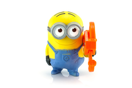 grabber: Bangkok,Thailand - October 11, 2014: Minion Dave gadget grabber toy character from Despicable Me animation movie. There are plastic toy sold as part of the McDonalds Happy meals. Editorial