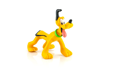 disney cartoon: Bangkok,Thailand - October 11, 2014: Pluto dog figure toy model character from Disney  Mickey mouse and friend.