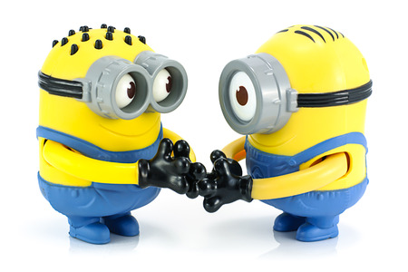 Bangkok,Thailand - October 30, 2014: Minion check hand toy character from Despicable Me animation movie.. There are plastic toy sold as part of the McDonalds Happy meals.