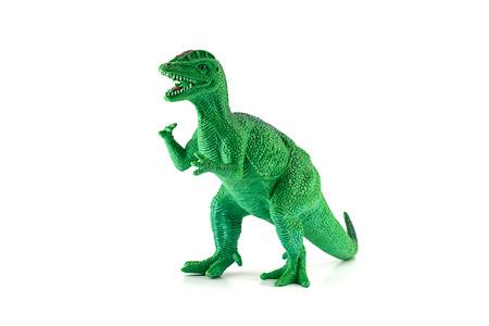 juguete: Dilophosaurus figura dinosaurio de juguete aislado en blanco.