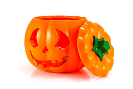 caving: Halloween pumpkin bucket head isolated on white