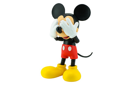mouse animal: Bangkok, Thailand - January 5, 2015: Mickey Mouse action figure the official mascot of The Walt Disney Company. Mickey Mouse is a funny animal cartoon character was created by Walt Disney studio. Editorial