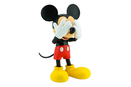 disney cartoon: Bangkok, Thailand - January 5, 2015: Mickey Mouse action figure the official mascot of The Walt Disney Company. Mickey Mouse is a funny animal cartoon character was created by Walt Disney studio. Editorial
