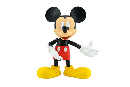mouse: Bangkok, Thailand - January 5, 2015: Mickey Mouse action figure the official mascot of The Walt Disney Company. Mickey Mouse is a funny animal cartoon character was created by Walt Disney studio. Editorial