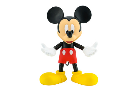 Bangkok, Thailand - January 5, 2015: Mickey Mouse action figure the official mascot of The Walt Disney Company. Mickey Mouse is a funny animal cartoon character was created by Walt Disney studio. Editorial