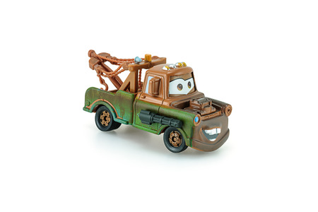 disney: Bangkok,Thailand - January 26, 2014: Tow Mater pick-up truck with machine gun a main protagonist of the Disney Pixar feature film Cars. A diecast cars collcetion from mattel inc.
