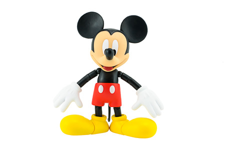 mickey: Bangkok, Thailand - January 5, 2015: Mickey Mouse action figure the official mascot of The Walt Disney Company. Mickey Mouse is a funny animal cartoon character was created by Walt Disney studio. Editorial
