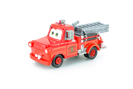 Bangkok, Thailand - January 11, 2015 : Tow Mater toy character from Pixar CARS film. Product by tomica in red Mater rescue squad tomy 2007.