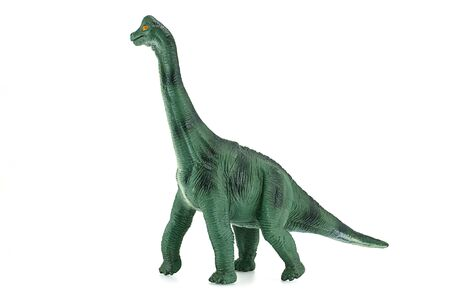 juguetes antiguos: Juguete dinosaurios Apatosaurus sobre fondo blanco.