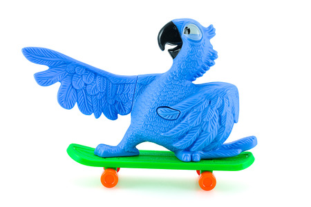 Bangkok,Thailand - February 24, 2015: Blu the  blue macaws on sketboard toy character form RIO animation film. There are plastic toy sold as part of the McDonalds Happy meals.