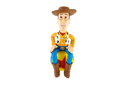 toy story: Bangkok,Thailand - February 08, 2015: Sherrif Woody toy on red star ball a fictional character in the Toy Story franchine. This figure by disney Pixar.