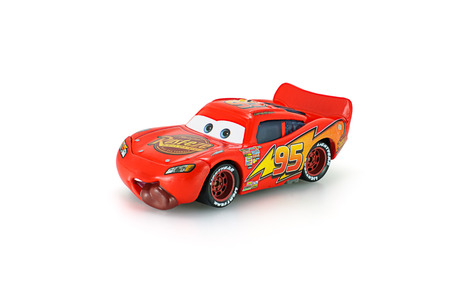 rusty car: Bangkok,Thailand - February 08, 2015: Tongue Lighting Mcqueen toy car a protagonist of the Disney Pixar feature film Cars. A diecast cars collection from Takara Tomy.