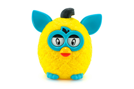 Bangkok, Thailand - March 21, 2014: Yellow furby from Furby Boom collection toy series. There are plastic toy sold as part of the McDonald's Happy meals.