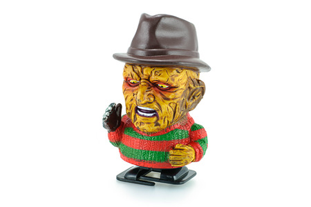 Bangkok,Thailand - March 19, 2015: Freddy Krueger wind up toy characters from a nightmare on elm street series. Freddy is the main antagonist who uses a glove armed with razors to kill his victims in their dreams.