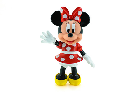 mickey: Bangkok, Thailand - Apirl 22, 2015: Toddler Minnie mouse action figure from Disney character. This character from Mickey mouse and friend animation series.