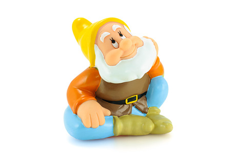 dwarfs: Bangkok,Thailand - April 26, 2015: .Happy figure toy is one of the seven dwarfs. The character appeared in Disneys Snow White and the Seven Dwarfs.