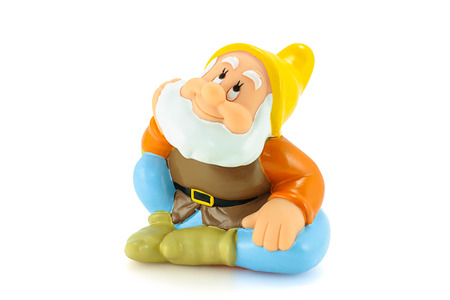 disney: Bangkok,Thailand - April 26, 2015: .Happy figure toy is one of the seven dwarfs. The character appeared in Disneys Snow White and the Seven Dwarfs.