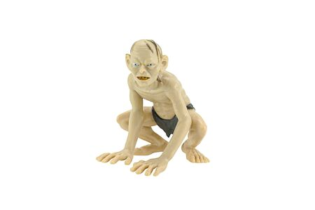 fictional character: Bangkok,Thailand - April 26, 2015: Gollum isolated on white action figure toy a fictional character from The Hobbit and The Lord of the Rings.
