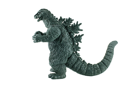 bombings: Bangkok,Thailand - April 26, 2015: Godzilla King of the Monsters figure toy. Godzilla is a giant monster or daikaiju originating from a series of tokusatsu films of the same name from Japan