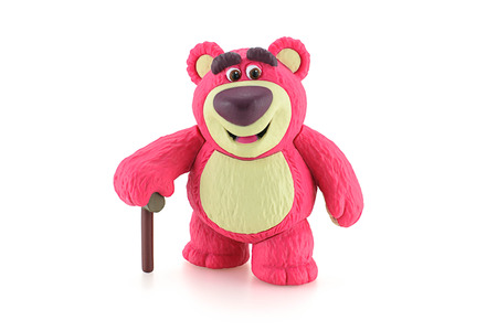 toy story: Bangkok,Thailand - April 19, 2015: Lotso Huggin Bear on white background figure toy character from Disney Pixar Toy Story animation film.
