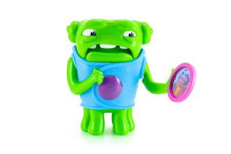 animated alien: Bangkok,Thailand - April 17, 2015: Nervous OH alien green color toy character from Dreamworks HOME animation movie. There are plastic toy sold as part of the McDonalds Happy meals.