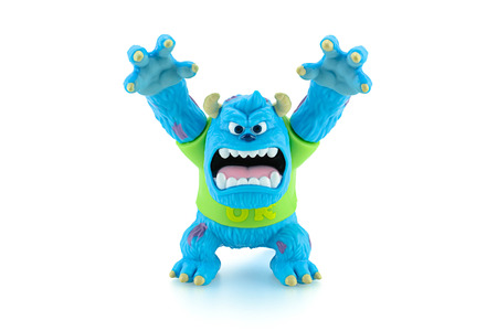 disney cartoon: Bangkok,Thailand - March 19, 2015: Scarers James P. Sullivan Sulley figure toy character from Monsters University movie by Disney Pixar animation studio.