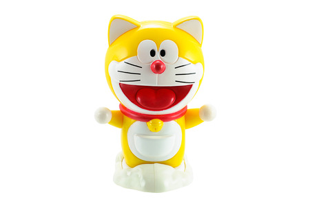 japanes: Bangkok,Thailand - March 21, 2015: Yellow Doraemon a robot cat protagonist of Doraemon Japanes animation cartoon. There are plastic toy sold as part of the McDonalds Happy meals. Editorial