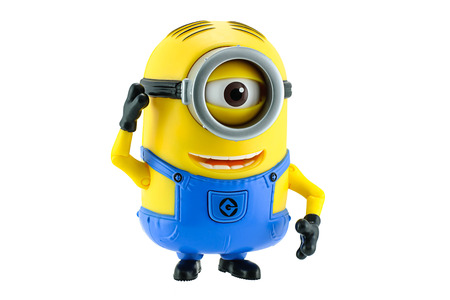 isolated on yellow: Bangkok,Thailand - May 17, 2015: Minions toy isolated on white background an action figure from Despicable Me 2 animated 3D film produced by Illumination Entertainment for Universal Pictures. Editorial