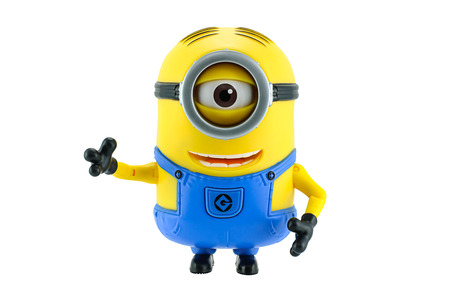 animated action: Bangkok,Thailand - May 17, 2015: Minions toy isolated on white background an action figure from Despicable Me 2 animated 3D film produced by Illumination Entertainment for Universal Pictures. Editorial