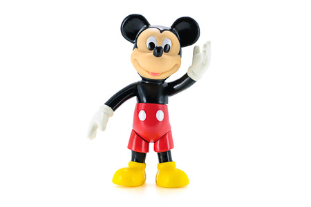 Bangkok Thailand  May 5 2015: Toddler Mickey Mouse action figure the official mascot of The Walt Disney Company. Mickey Mouse is a funny animal cartoon character was created by Walt Disney.