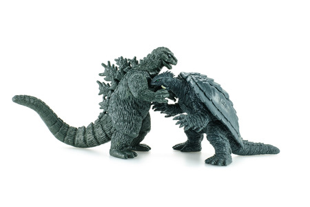 bombings: Bangkok,Thailand - April 26, 2015: Godzilla vs Gamera Death battle figure toy character. Godzilla is a giant monster or daikaiju originating from a series of tokusatsu films of the same name from Japan